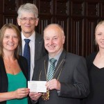 Maree and Corinne receiving a cheque for £1,000 from the Lord Provost George Adam